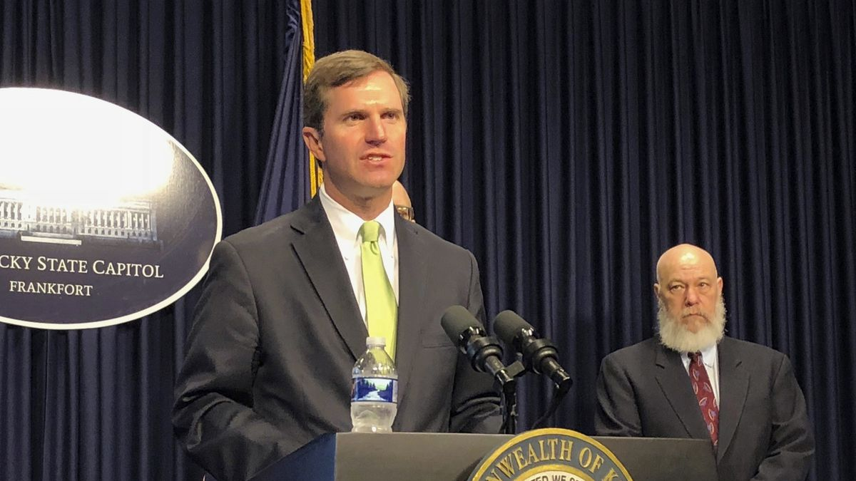 FILE - In this March 13, 2020 file photo, Kentucky Gov. Andy Beshear discusses developments in Kentucky regarding the new coronavirus in Frankfort, Ky.  Beshear ordered bars and restaurant dine-in services to close in another aggressive step to contain the new coronavirus as the state reported its first death linked to the illness.(AP Photo/Bruce Schreiner)
