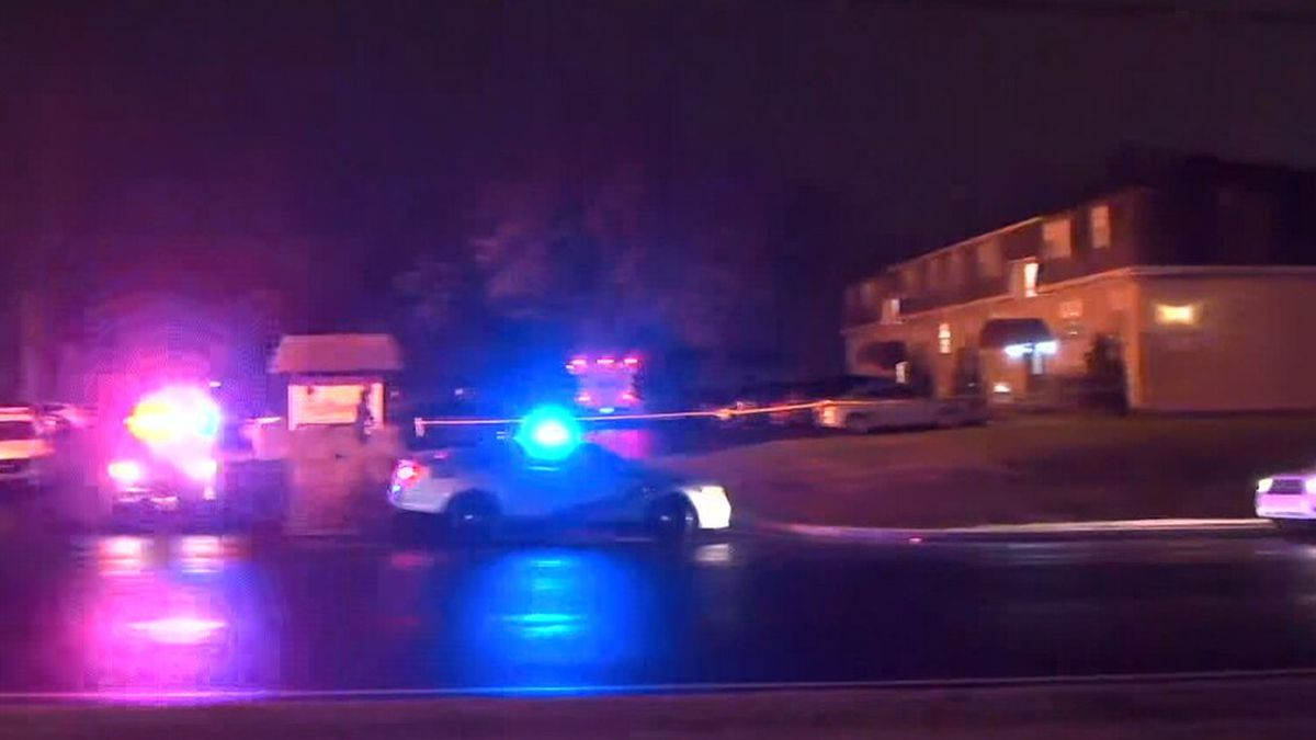 Two people were found dead inside a vehicle at the apartment complex. (Source: WAVE)