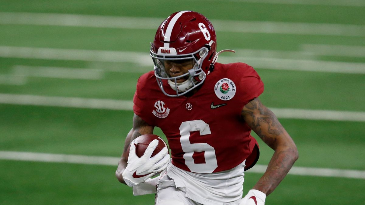 Alabama wide receiver DeVonta Smith (6) gains yardage after a catch in the first half of the...